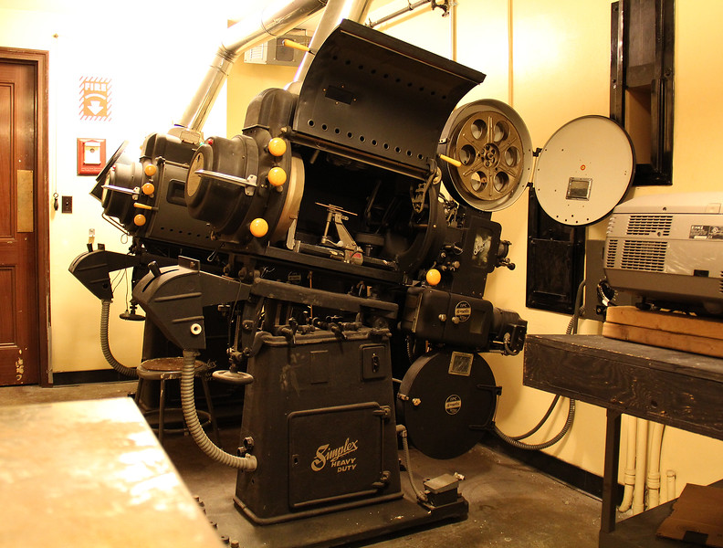 These are the old carbon arc movie projectors in the projection booth in Lynn Auditorium that haven't been used in decades. The lamps ran really hot and required special ventilation and could be dangerous to operate. Photo by Owen O'Rourke
