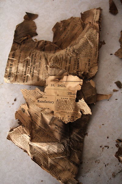 Thsi newspaper from 1875 was found in the attic at 7 Franklin Street in Lynn. Photo by Owen O'Rourke