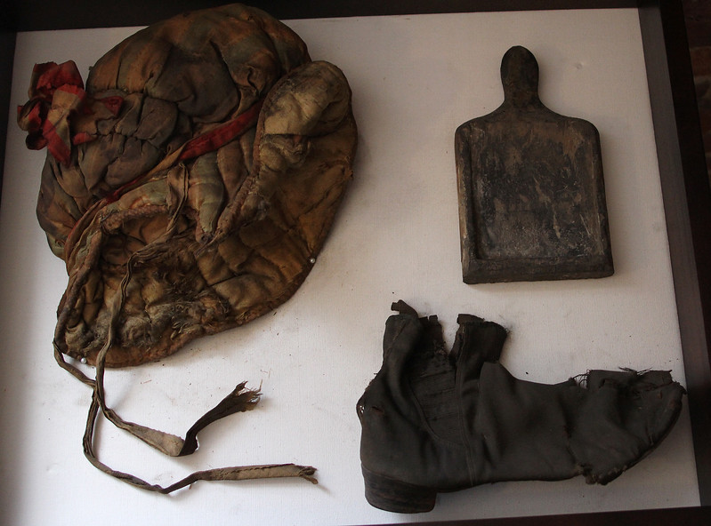 These three items were found in the attic at 7 Franklin Street in Lynn. There is a hat, a shoe and a mystry tool. Photo by Owen O'Rourke