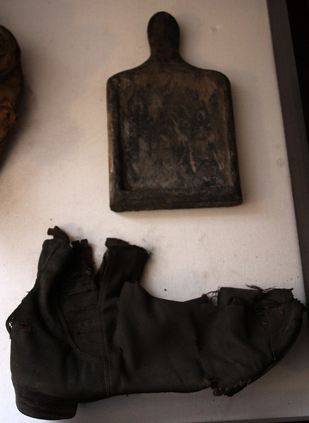 Some of the items found in the attice at 7 Franklin Street. The bottom item is a shoe and the item above is still a question mark. Photo by Owen O'Rourke