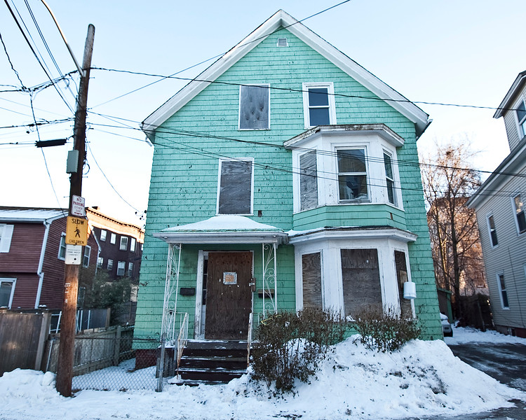 The home at 13 Lander Avenue in Lynn, which is on course to be demolished, on Friday, January 24. Item Photo / Angela Owens.