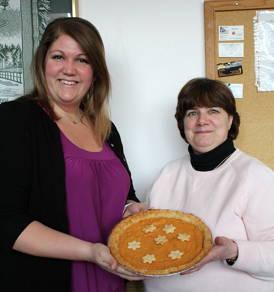 Cathy Rowe, left, and Barbara Morrison, right, both from Lynn Housing Authority& Neighborhood Development, with a sweet potato pie, one of the many pies they sold at the 3rd annual pie day today, National Pie Day. All money raised went to the outreach fund. Photo by Owen O'Rourke