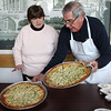 Barbara Morrison, and John Pace sold both sweet and pizza pies at the Lynn Housing Authority & Neighborhood Development's 3rd annual pie day held at Caggiano Plaza in Lynn today to celebrate National Pie Day and to raise money for the outreach fund. Photo by Owen O'Rourke