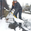 Lynn, Ocean Street.  Elaine  Letowski, Lynn, shovels the snow off the sidewalk before it freezes Saturday night.