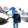 Lynn, Ocean Street.  Dino Takles, Lynn, walks home after having brunch at a restaurant on Humphrey Street.  The snow had changed to rain by then.