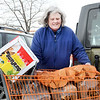 Salem.  Home Depot parking lot.  Kathy Smith, Marblehead, stocking up on wood prior to the predicted blizzard.  She is preparing for a power outage during the storm.