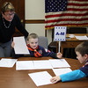 Nahant Town Clerk Peggy Barile, left, helps Cub Scouts Brayden McCarthy, middle, and Quinn Sainato, right, count the ballotts in the mock election held in Nahant Town Hall. Photo by Owen O'Rourke