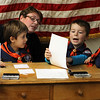 Nahant Town Clerk Peggy Barile helps Matthew Conant, Quinn Sainato, and Brayden McCarthy, all of Cub Scout troop 50, call out the results of the mock election they had at Nahant Town Hall today. Photo by Owen O'Rourke