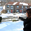 Gina Ricupero standing in her front yard on Osborne Street in Lynn.The coyotes she saw at two in the moring last week were walking up the hill across the street next to the building. Photo by Owen O'Rourke