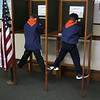Brayden McCarthy, left, and Quinn Sainato, right, both from Nahant Cub Scout troop 50, vote in the mock election at Nahant Town Hall today. Photo by Owen O'Rourke