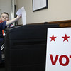 Cub Scout T. J. Ballantine, left, troop 50, votes under the watchful eye of the election warden Brayden McCarthy, right, also of troop 50, during a mock election at Nahant Town Hall today.  Photo by Owen O'Rourke