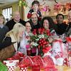 Margaret Ciota, left front row, smelling the roses at Tony the Florist, an 83 year old business on Western Ave in Lynn. Others in the photo are Stephanie Russo, Antonietta Ciota, Vernell Brock and Joe Ciota. Behind them are Hazel Kiefer, Frank Ciota, Joe Ciota, and Gabriele Ciota. Photo by Owen O'Rourke