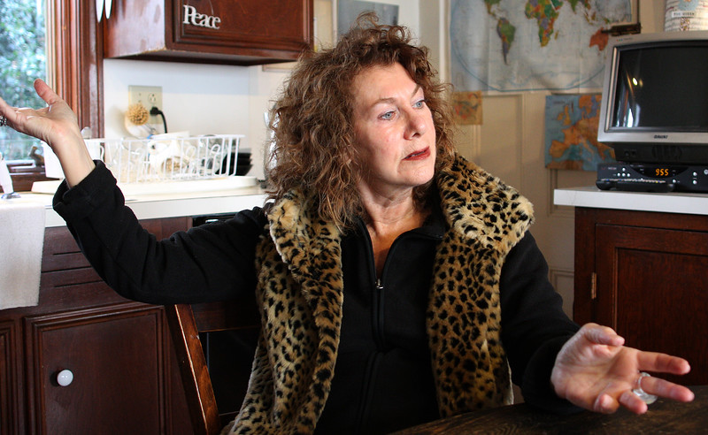 Ellie Miller  sits in her kitchen at 57 Greenwood Ave, Swampscott, and talks about the proposed use of old  Middle School two doors away. Photo by Owen O'Rourke