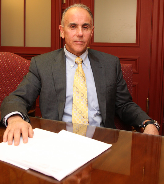 Saugus Town Manager Andrew Bisignani in his office at Saugus Town Hall. He will be leaving this position to take a new position as the Town Manager of Nahant. Photo by Owen O'Rourke
