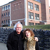 Freddy Phillips and his wife Ellie Miller standing in front of the old Middle School building on Greenwood Avenue in Swampscott. Their house is located two doors away from the school, and as a result, they both have questions as to the future of the school building. Photo by Owen O'Rourke