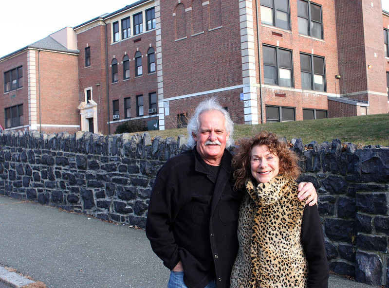 Freddy Phillips, left, and his wife Ellie Miller stand in front of the old Middle School building on Greenwood Avenue in Swampscott. Their house is two doors away from the school building, and both of them are concerned with the proposed use of the building. Photo by Owen O'Rourke