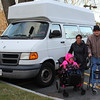 Joalani Harrold, her mom Tatiana Cedano, and John McCaskill, who donated money from selling his car to held buy this van for Tatiana, outside of their home at 25 Magner Road in Lynn today. Photo by Owen O'Rourke