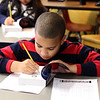 Armany Tavarez, third grade at Hood Elementary School in Lynn, writes his name in the new dictionary he received from the Equitable Bank and the Lynn Rotary. Photo by Owen O'Rourke