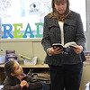 Jackie Hernandez, third grade at Hood Elementary School in Lynn, Lynn, listens to Wendy Silva, President of the Lynn Rotary and manager of Eastern bank on Boston Street, reads from the new dictionary every third grade student in Lynn received today.. Photo by Owen O'Rourke