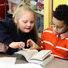 Emerald White, left, and Alejandro Nina Duran, right, both third grade students at the Hood Elementary School in Lynn, look up the longest wourd in the English language in their new dictionaries compliments of the Lynn Rotary and Equitable Bank.