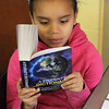 Melany Garcia, third grade at Hood Elementary School in Lynn, checks out the new dictionary he received from the Equitable Bank and the Lynn Rotary. Photo by Owen O'Rourke
