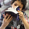 Alberto Gerardo, third grade at Hood Elementary School in Lynn, takes a good look at  the new dictionary he received from the Equitable Bank and the Lynn Rotary. Photo by Owen O'Rourke