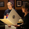 Lynn City Councilor Dianna Chakoutis gives Joe Abelon a citation for all of the work he has done with runners over the years.The presentation was held at the Old Tyme Italian Cuisine restaurant in Lynn.  Photo by Owen O'Rourke