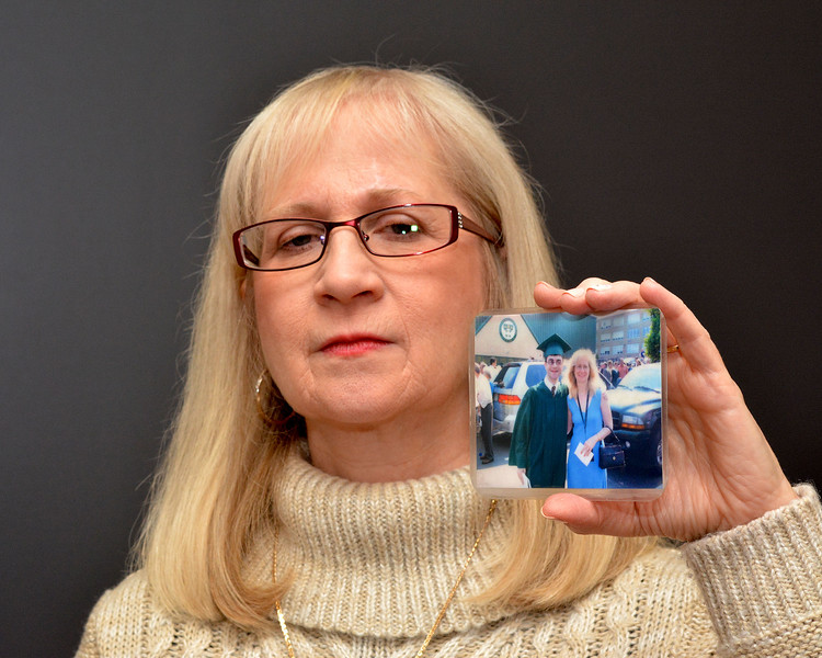 Lynn.  Item Office. Lynnette Alameddine, Saugus, whose son was killed during the Virginia Tech. shootings. To accompany Gayla's article. She is holding a picture of herself taken with her son at his high school graduation.