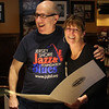 Joe Abelon, left, receiving a citation from Dianna Chakoutis on behalf of the Lynn City Council for his work over the years with runners. The luncheon was held at the Old Tyme Italian restaurant iln Lynn. Photo by Owen O'Rourke