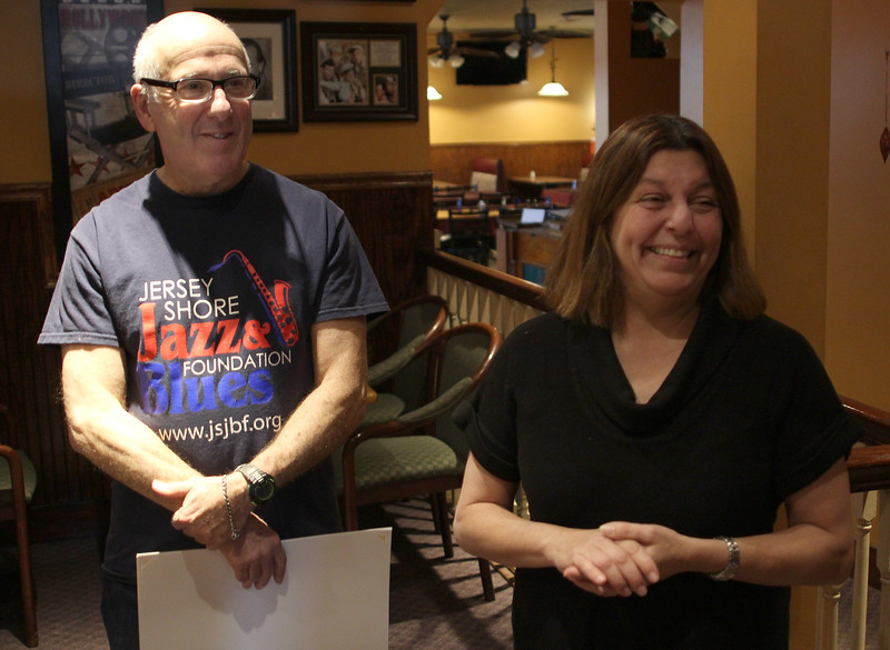 Joe Abelon, left, citation in hand, listens to Mayor Judith Flanagan Kennedy praise his contribution to runners over the years. The event was held at the Old Tyme Italian Cuisine restaurant in Lynn. Photo by Owen O'Rourke