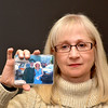 Lynn.  Item Office. Lynnette Alameddine, Saugus, whose son was killed during the Virginia Tech. shootings. She holds a picture of herself with her son taken at her son's high school graduation.