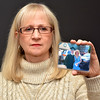 Lynn.  Item Office. Lynnette Alameddine, Saugus, whose son was killed during the Virginia Tech. shootings. She holds a picture of herself taken with her son at his high school graduation.