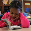 Janeyssy Morillo, a third grade student at the Cobbet Elementary School in Lynn, uses the new dictionary she received from members of the Lynn Rotary Club to look up the word rectangle today. The Lynn Rotatry is giving dictionaries to all one thousand third grade students in the City of Lynn. Photo by Owen O'Rourke