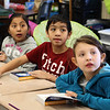 From left to right: Yadir Zacarias-Mendez. Kevin Heng, and Aylin Medina , all third grade students at the Cobbet Elementary School in Lynn, after receiving their new dictionary complimentns of the Lynn Rotary Club. Photo by Owen O'Rourke