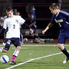St. Mary's Dan Hennessey (2) sends the ball past Archbishop Williams' Jack McCarry (5) during their game at Manning Field on Thursday, October 11. Item Photo / Angela Owens.