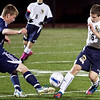 Archbishop Williams' Collin Higgins (19) and St. Mary's Andrew DiMaiti (16) vie for the ball during their game at Manning Field on Thursday, October 11. Item Photo / Angela Owens.