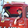 Swampscott. Classic Car Show.  Monument Ave.<br /> Brendan McManus, Lynn, tries out the drivers seat of a 1952 GMC semi truck owned by Ed Shea of Tewksbury.