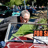 "Swampscott. ""Classics By the Sea"" car show.  Monument Ave.<br /> Vladimir Yarmarkovich, Swampscott, has a look at a for sale car in the show.  ""I am here to enjoy the day and look at the fun cars"""