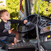 Maddox Powers, of Saugus, grabs the wheel of a Saugus ladder truck at Saugus Fire Awareness Day at Saugus Fire Headquarters on Saturday, Oct. 15, 2016. (Photo by Scott Eisen/The Item)