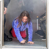 Hayley O'Brien, 10, of Saugus, crawls out of a room with a simulated fire in it at the Saugus Fire Awareness Day at Saugus Fire Headquarters on Saturday, Oct. 15, 2016. (Photo by Scott Eisen/The Item)