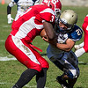 Winthrop High School football running back Jon Gonzalez attempts to tackle Saugus High School running back Marvens Moise during a game in Saugus on Saturday, Oct. 15, 2016. (Photo by Scott Eisen/The Item)