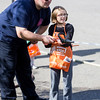 Ava Mactaggart, 9, is helped by Saugus Firefighter Anthony Arone while spraying a fire hose at Saugus Fire Awareness Day at Saugus Fire Headquarters on Saturday, Oct. 15, 2016. (Photo by Scott Eisen/The Item)