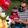 Dillon Dispersio Jr., is held by his father Dillon as they meet Sparky the dog during the Saugus Fire Awareness Day at Saugus Fire Headquarters on Saturday, Oct. 15, 2016. (Photo by Scott Eisen/The Item)