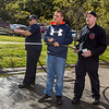 Chris Ferrara, 13, of Saugus, sprays a hose from a fire engine with the help of Saugus Firefighter Ryan Poussard, right, during the Saugus Fire Awareness Day at Saugus Fire Headquarters on Saturday, Oct. 15, 2016. (Photo by Scott Eisen/The Item)
