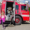 Stephanie Lewis, of Saugus, walks away from a Saugus Ladder Truck during the Saugus Fire Awareness Day at Saugus Fire Headquarters on Saturday, Oct. 15, 2016. (Photo by Scott Eisen/The Item)