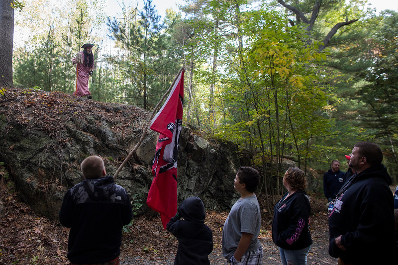 Participants in the Pirates' Day in Lynn Woods meet the first pirate on their journey around a trail on Saturday, Oct. 15, 2016. (Photo by Scott Eisen/The Item)