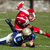Saugus High School quarter back Mike Mabee Jr.  is tackled by Winthrop High's Christopher Zuffante during a game in Saugus on Saturday, Oct. 15, 2016. (Photo by Scott Eisen/The Item)