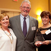 Daily Item publisher Peter Gamage presents the Businesswoman of the Year award for intermediate business to Lisa Almedia, left, and Heidi Nicholson of Bella Sera Bridal at the annual North of Boston Businesswomen of the Year awards at the Holiday Inn in Peabody on Wednesday, October 23. Item Photo / Angela Owens.