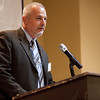 Daily Item general manager Phil Ouellette speaks at the annual North of Boston Businesswomen of the Year awards at the Holiday Inn in Peabody on Wednesday, October 23. Item Photo / Angela Owens.