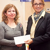 Narine Musaelyan, left, recieves the BNI Lynn Chapter scholarship, presented by Cathy Anderson of North Shore Community College, during the annual North of Boston Businesswomen of the Year awards at the Holiday Inn in Peabody on Wednesday, October 23. Item Photo / Angela Owens.